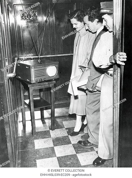 Portable television in a New York City elevator, Oct. 5, 1949. The operator brought his TV to work so he could watch the first game of the World Series between...