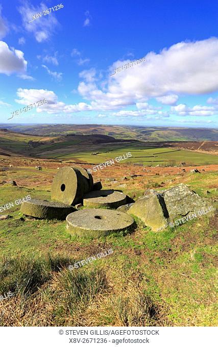 Millstones below Stanage Edge near Hathersage, Peak District National Park, Derbyshire, England, UK
