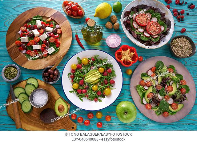 assortment of salads and healthy vegan ingredients on turquoise table