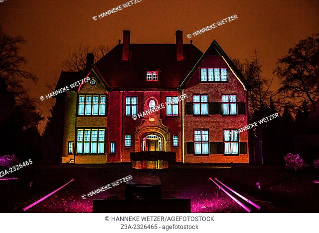 Spooky and fairytale like lit house during the Glow festival in Eindhoven, the Netherlands