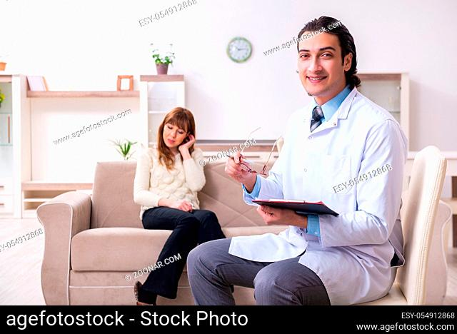 The young female patient discussing with male psychologist personal