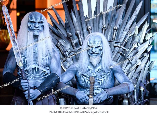 "15 April 2019, Hamburg: Two men dressed up as """"White Walkers"""", known from the fantasy series """"Game of Thrones"""", are to be seen in the evening at the..."