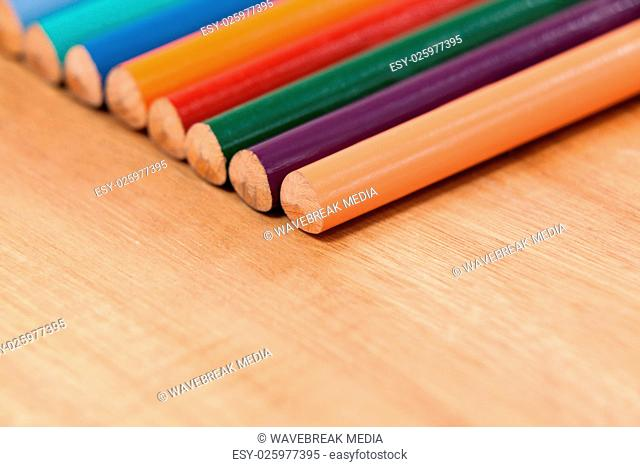 Close-up of colored pencil in a row