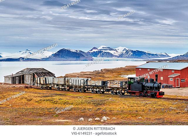 old coal train and view from the Northernmost civilian and functional settlement Ny-Ålesund on the landscape with the three crones, Svalbard or Spitsbergen