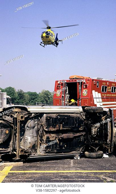 Medivac helicopter flies over accident scene