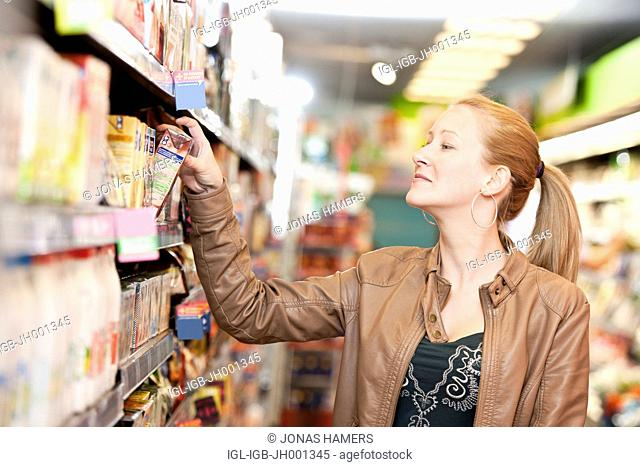 Client walking and choosing goods and food in a supermarket