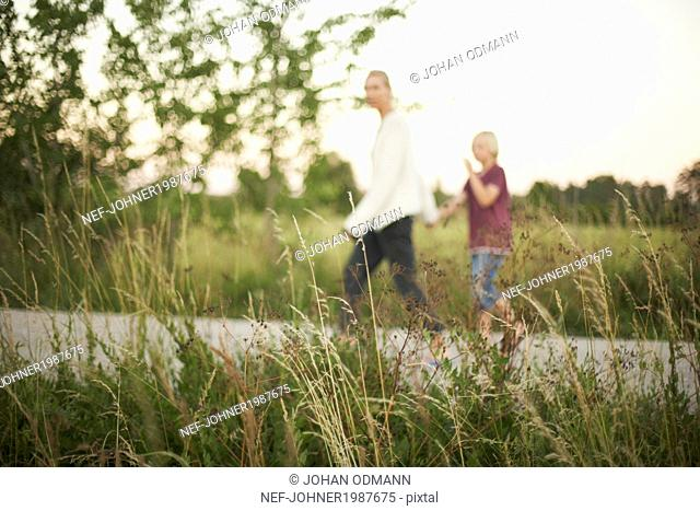 Mother walking with son