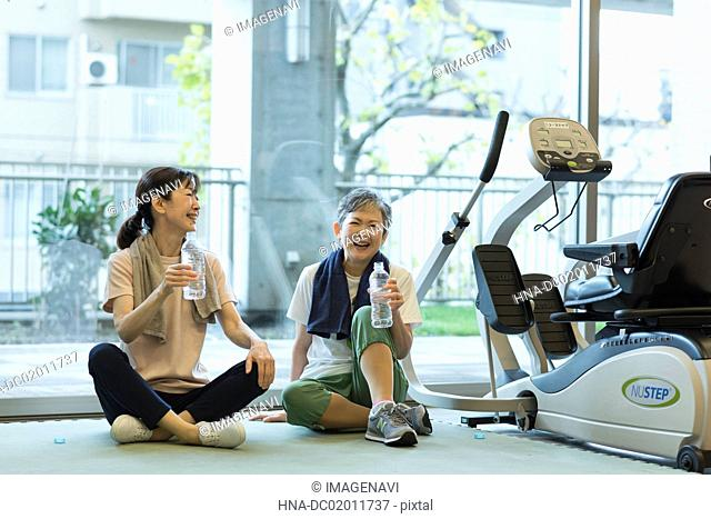 Senior woman chatting at gym