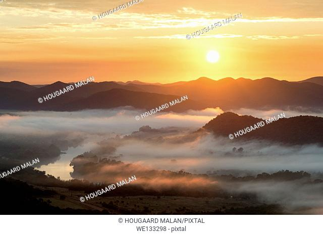 Landscape photo of a colourful sunrise over a misty Vaal River valley. Vredefort Dome, Freestate, South Africa