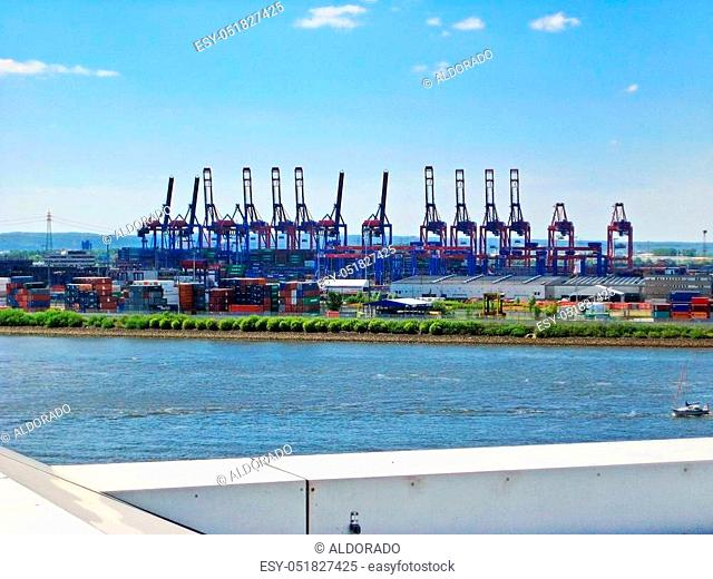Hamburg, Germany - May 22, 2008: Hamburg harbor - container terminal. Cranes for loading ships, river Elbe / Norderelbe in front