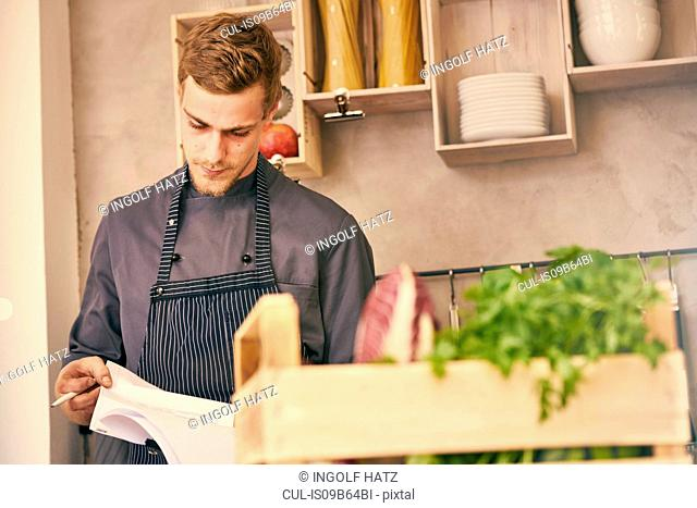 Chef looking at paperwork