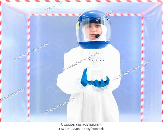 person in protective suit holding biohazard samples