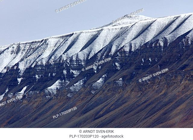 Snow covered eroded mountain slope at Adventdalen, Longyearbyen, Svalbard / Spitsbergen