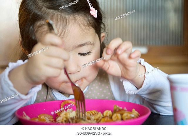 Girl using fork