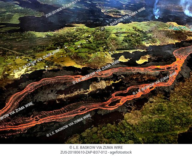 June 10, 2018 - Pahoa, Hawaii, U.S - The Kilauea Volcano east rift zone eruption continues mainly from Fissure 8 and forms a river of lava flowing down to...