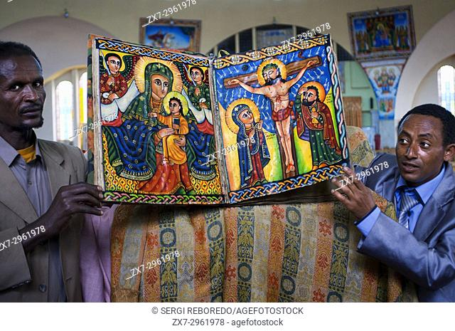St Mary of Zion church, Aksum, Ethiopia. Priests show the sacred books of the new church of St Mary of Zion in Axum. Ethiopian churches have several entrances:...