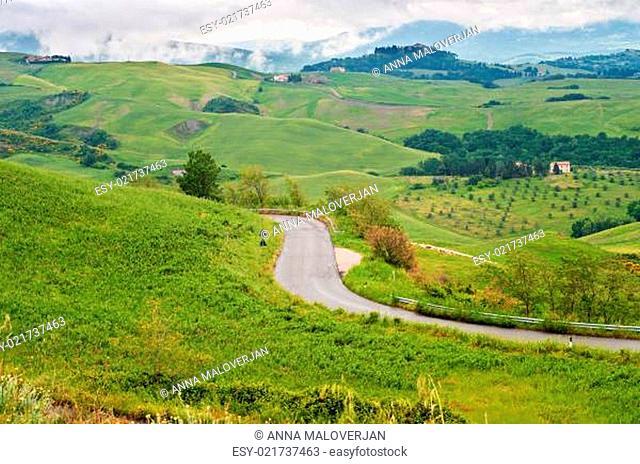 Winding road in Tuscana, Italy