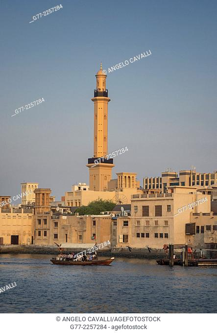 Mosque and traditional houses on Dubai Creek, Dubai, UAE