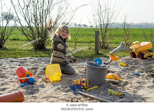 Boy playing in a sandbox