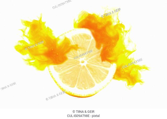 Half a lemon with corresponding coloured digital burst effect