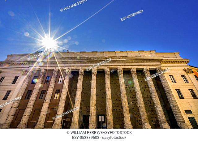 Temple of Hadrian Sun Rays Columns Colonnade Now Stock Exchange Rome Italy. Temple built 145 AD