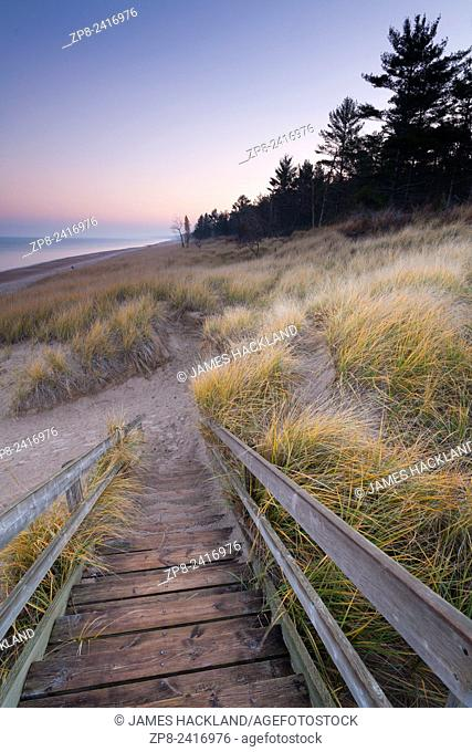 Stairs and a trail leading to a sandy beach along the shores of Lake Huron. Pinery Provincial Park, Ontario, Canada