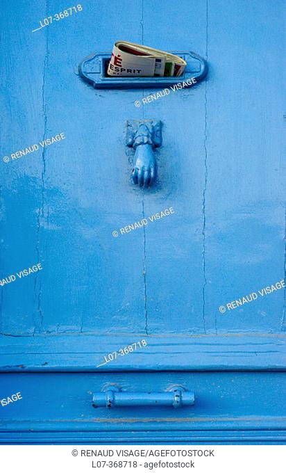 Blue door with letter drop and knocker. Cassis. France