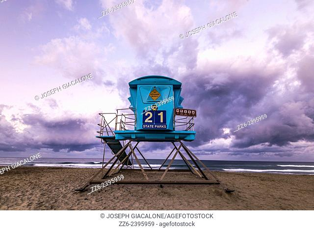 Blue colored lifeguard tower on Ponto Beach with storm clouds. Carlsbad, California, United States