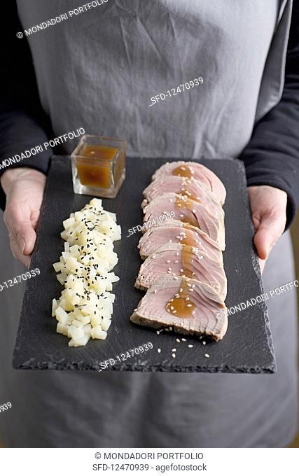 Tuna fish roast beef with sesame seed new potatoes and honey-mustard sauce