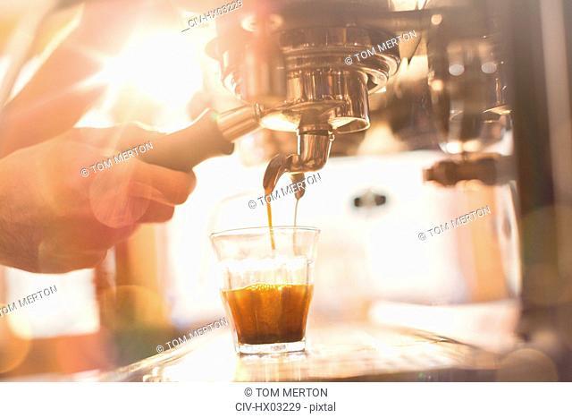 Close up hand of barista using espresso machine in cafe