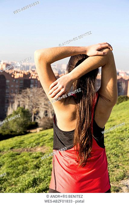Young woman stretching before running