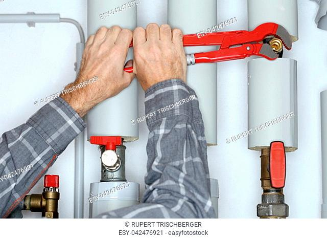 repairing a valve with a red gripper