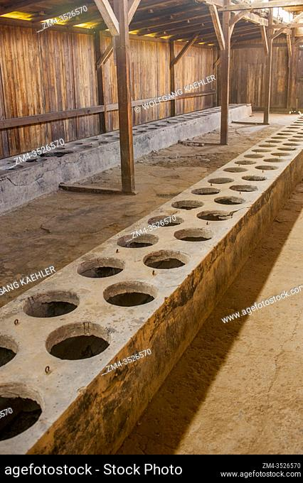 Latrines in the interior of the wooden barracks at the Birkenau concentration camp which was operated by Nazi Germany in occupied Poland during World War II and...