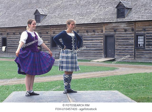 fort, dancing, Thunder Bay, Canada, Ontario, Two girls dressed in authentic costumes celebrate Scottish Days by doing the Highland Dance at the Main Square at...