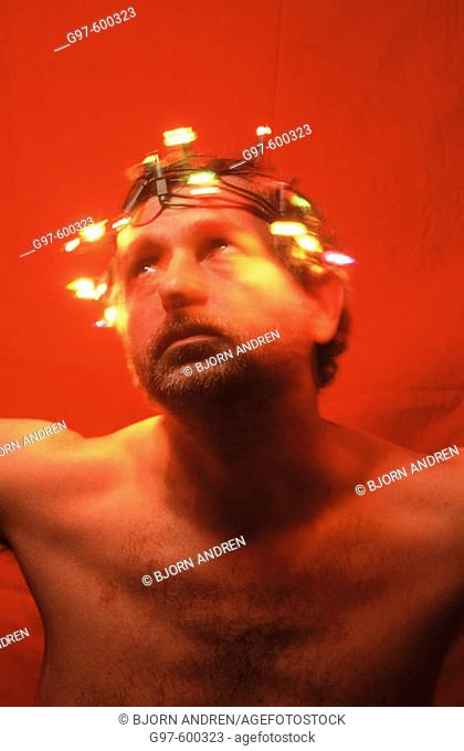 Man with crown of lights
