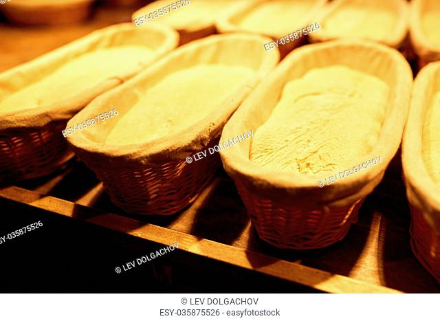 yeast bread dough in baskets at bakery kitchen