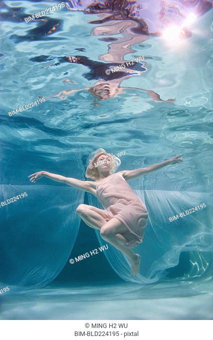Caucasian woman posing in pool
