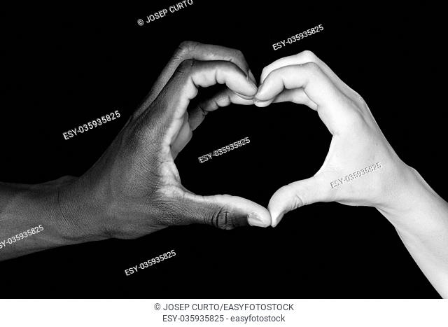 A hands of black man and white woman on black background,heart sing,