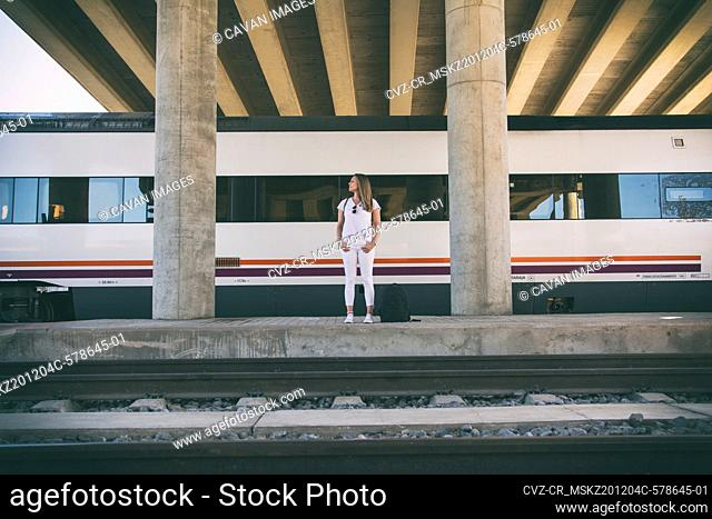 Woman Waiting For The Train. Travel Lifestyle