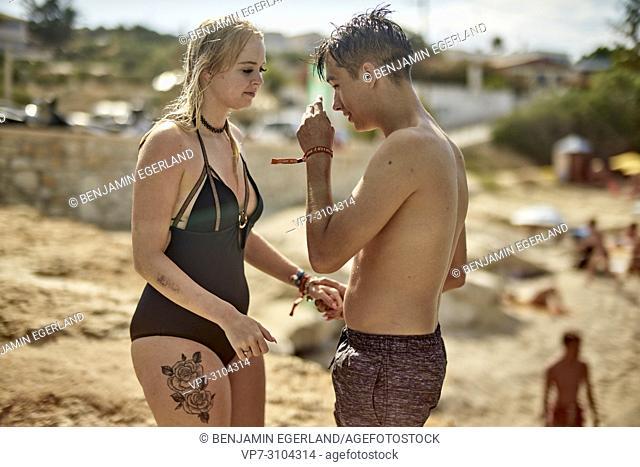 Greece, Crete, Chersonissos, couple in swimwear at beach
