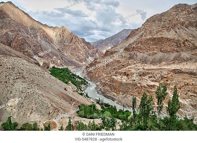 The Indus River flows though a valley in Baimah, Ladakh, Jammu and Kashmir, India. - BAIMAH, LADAKH, INDIA, 02/07/2014