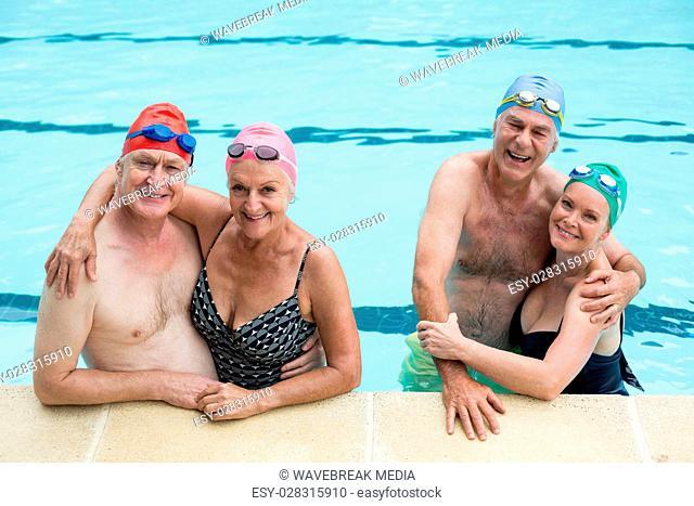 Senior couples enjoying in pool