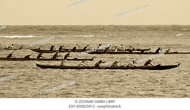 Canoe paddlers racing on ocean - an old photo style