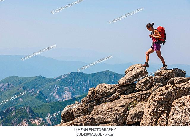Female hiker stepping on ridge on way to Daecheongbong peak, Seoraksan National Park in South Korea