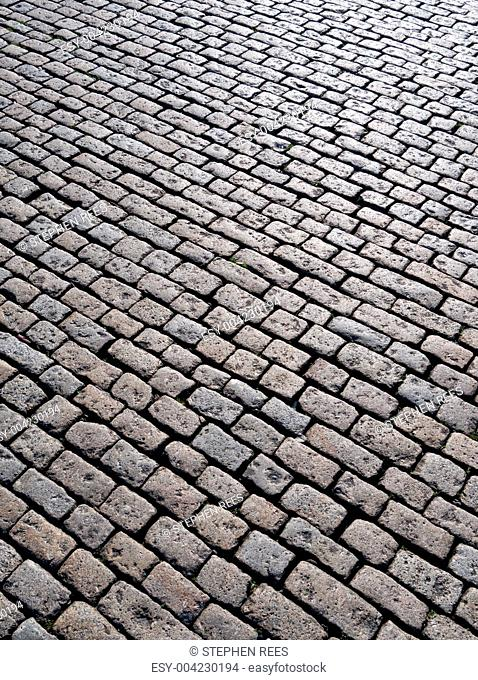 Old English cobblestones road in Plymouth close up