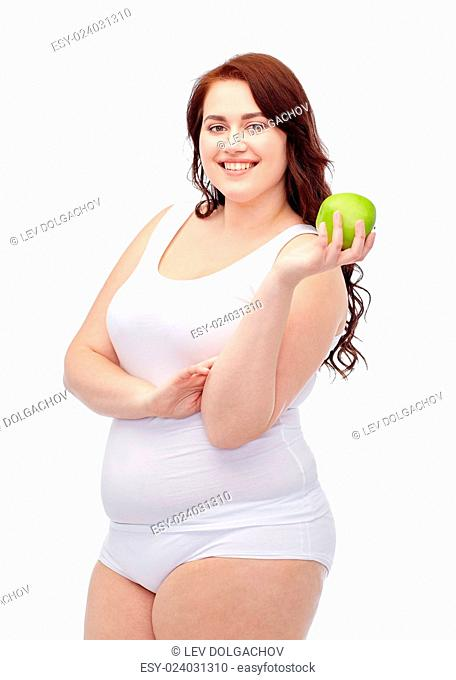 weight loss, diet, slimming, healthy eating and people concept - happy young plus size woman in underwear with green apple
