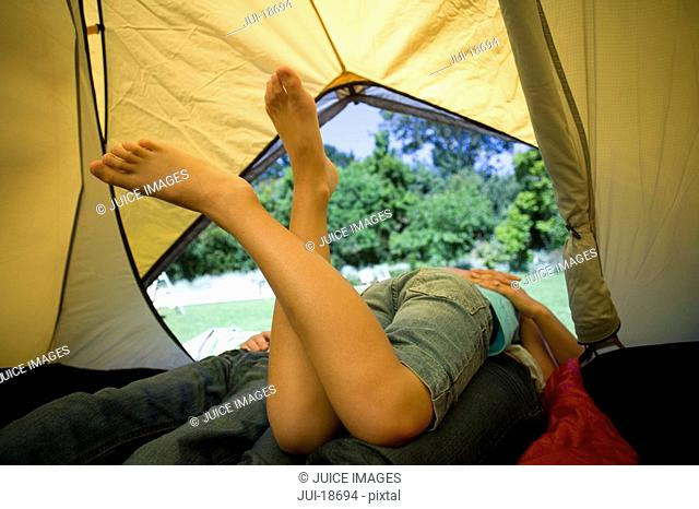 Family laying in tent
