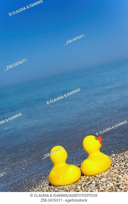 Two rubber ducks on Aegean beach