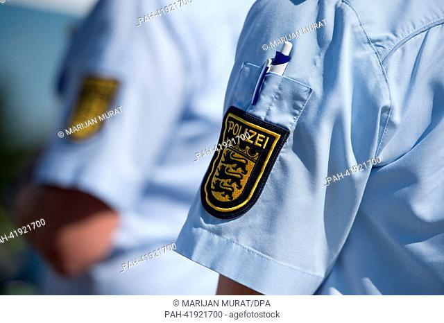 The badge of the Baden-Wuerttemberg police is seen on a shirt sleeve at motorway services Sindelfinger Wald at Autobahn A8 near Sindelfingen, Germany