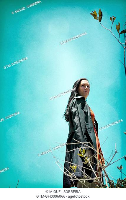 Windy Woman in Black Coat